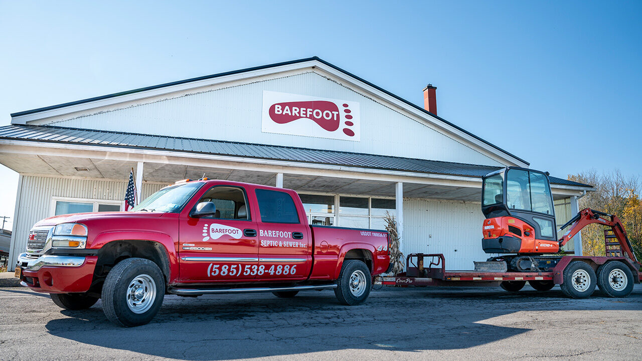 Barefoot Septic Truck and Building